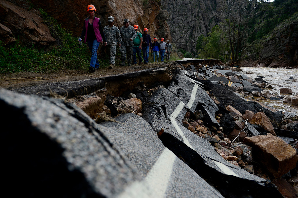 . LYONS, CO - SEPTEMBER 22: Colorado National Guard soldiers lead a group of CDOT and state employees during a tour to look at the damage caused by recent flooding in the area on U.S. Highway 36 between Lyons and Pinewood Springs. Pavement is missing in many section of the road that connects Lyons to Estes Park. (Photo by AAron Ontiveroz/The Denver Post)