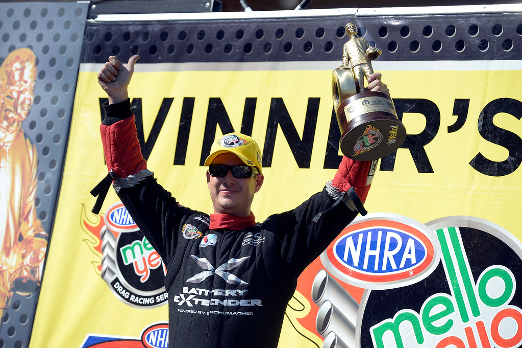 . SPencer Massey winner in the Top Fuel holds up his trophy in the winner\'s circle at the Mopar Mile-High NHRA Nationals July 21, 2013 at Bandimere speedway in Morrison. (Photo By John Leyba/The Denver Post)
