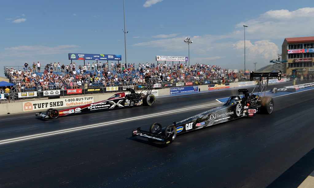 . Spencer Massey (L) defeats Bob Vandergriff in the Top Fuel Finals during the Mopar Mile-High NHRA Nationals July 21, 2013 at Bandimere speedway in Morrison. (Photo By John Leyba/The Denver Post)
