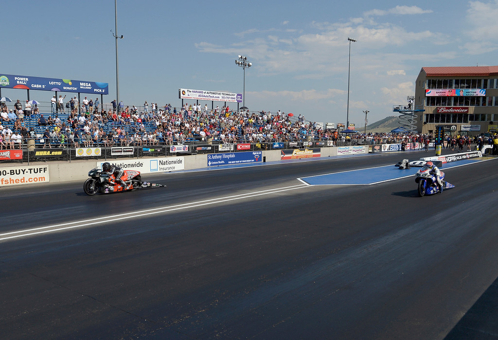 . Shawn Gann (L) defeats Hector Arana Jr. in the finals of the Pro Stock Motorcycle during the Mopar Mile-High NHRA Nationals July 21, 2013 at Bandimere speedway in Morrison. (Photo By John Leyba/The Denver Post)