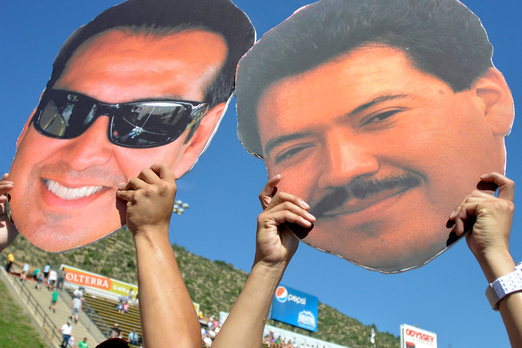. Fan hold up giant faces during the Mopar Mile-High NHRA Nationals  pre festivities July 21, 2013 at Bandimere speedway in Morrison. (Photo By John Leyba/The Denver Post)