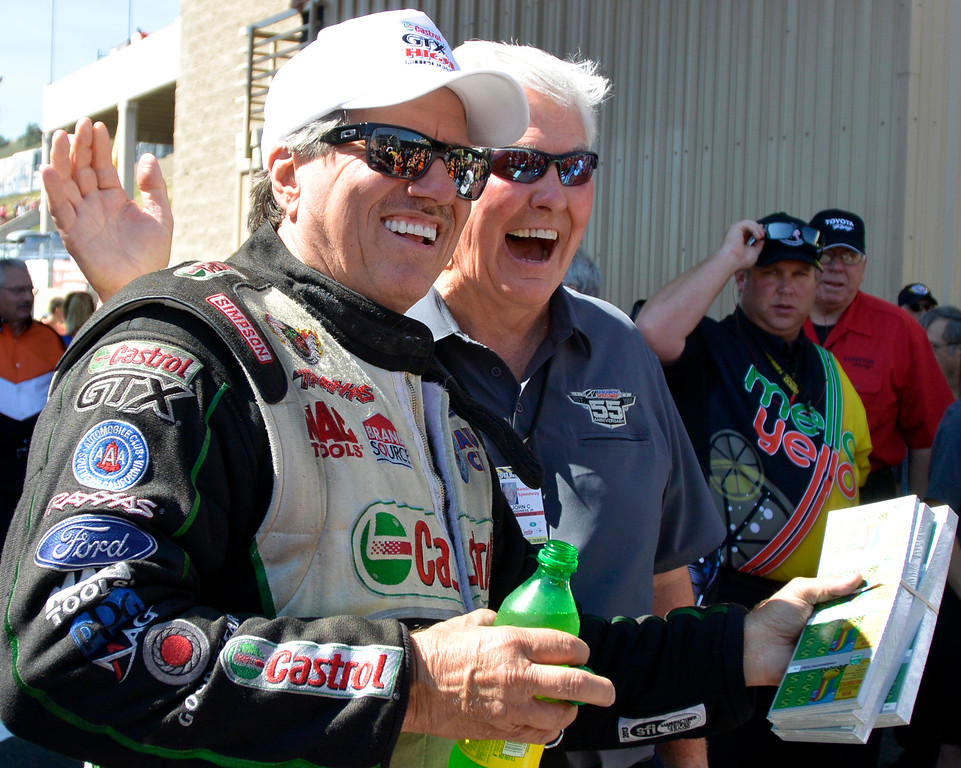 . John Force poses with John Bandimere during the pre race festivities at the Mopar Mile-High NHRA Nationals July 21, 2013 at Bandimere speedway in Morrison. (Photo By John Leyba/The Denver Post)