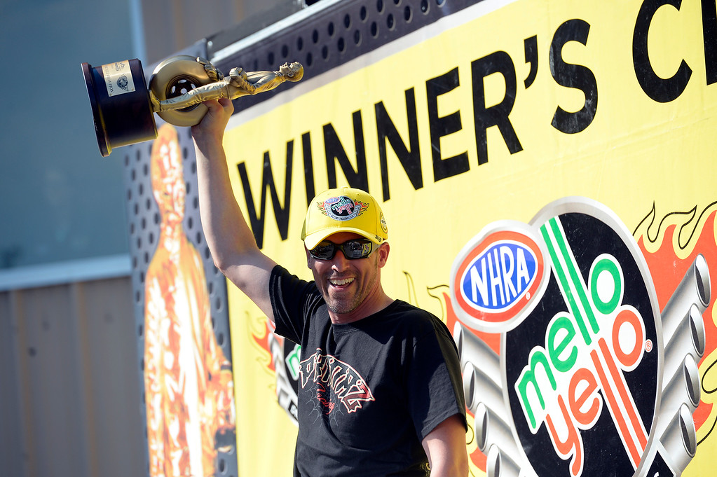 . Shawn Gann winner in the Pro Stock Motorcycle holds up his trophy in the winner\'s circle at the Mopar Mile-High NHRA Nationals July 21, 2013 at Bandimere speedway in Morrison. (Photo By John Leyba/The Denver Post)