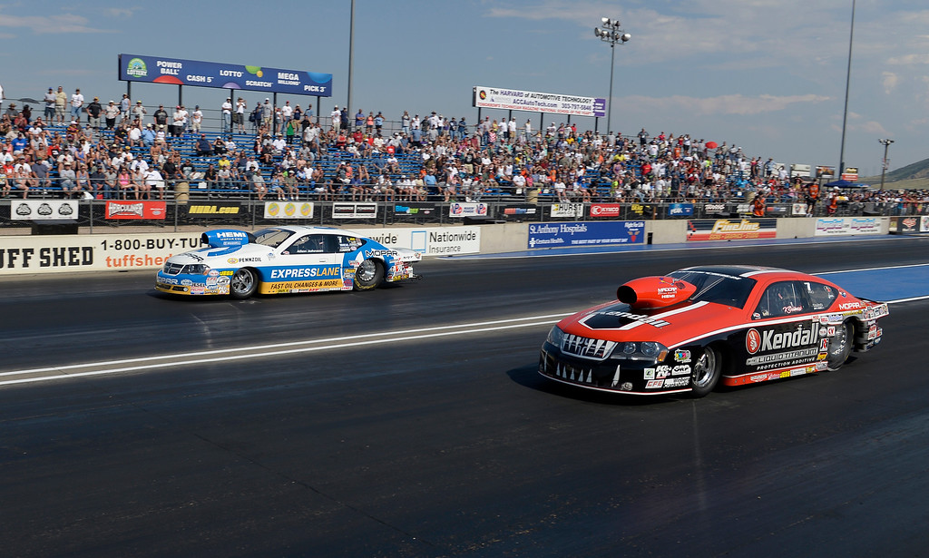 . Allen Johnson defeats V Gaines in the Pro Stock Finals during the Mopar Mile-High NHRA Nationals July 21, 2013 at Bandimere speedway in Morrison. (Photo By John Leyba/The Denver Post)