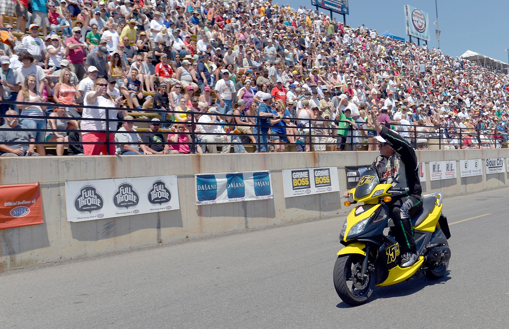 . John Force waves to the crowd after his first round loss to Bob Tasca III during the Mopar Mile-High NHRA Nationals July 21, 2013 at Bandimere speedway in Morrison. (Photo By John Leyba/The Denver Post)