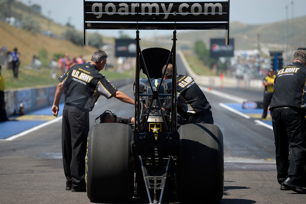 . Tony Schumacher prepares for his burnout during the Mopar Mile-High NHRA Nationals July 21, 2013 at Bandimere speedway in Morrison. (Photo By John Leyba/The Denver Post)