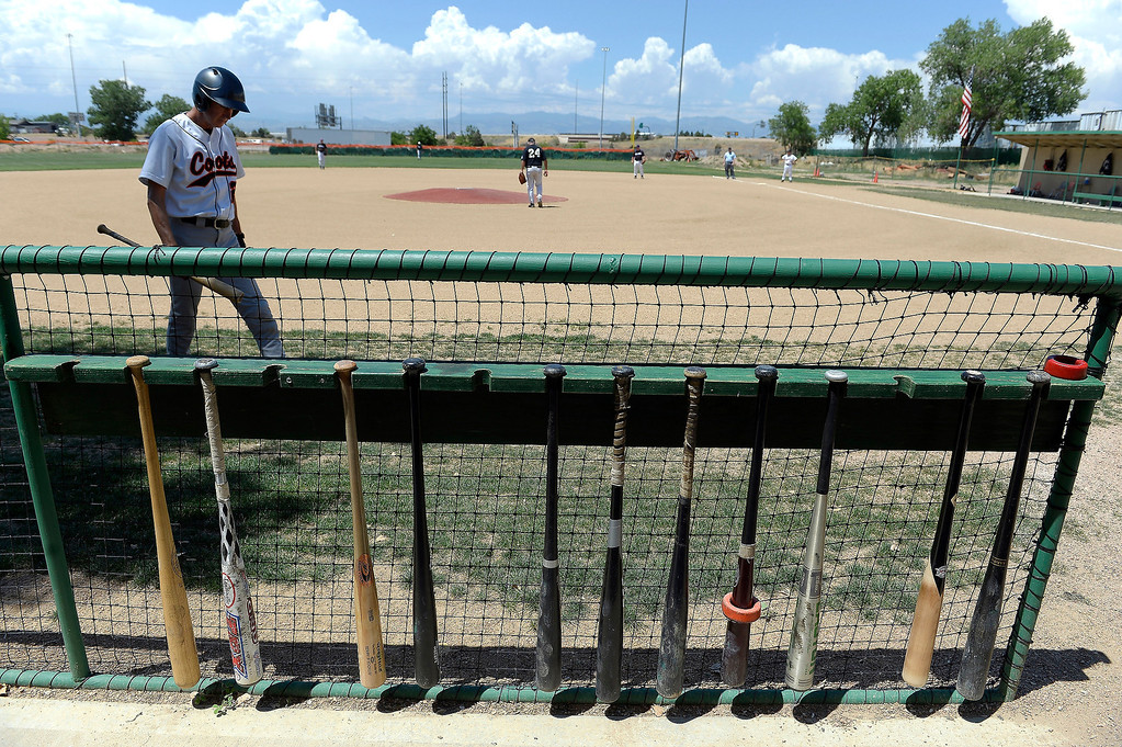 . A member of the Coots baseball team comes up to bat during their game at the old Mapleton High School field.  Mark Danuser has used his own money to create a baseball playing field and training facility in this north Denver neighborhood. (Photo By John Leyba/The Denver Post)