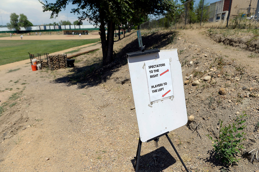 . A sign directs the players and spectators to the baseball field at Mapleton.   (Photo By John Leyba/The Denver Post)