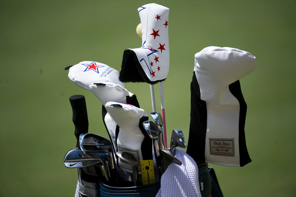 . Michelle Wie\'s Nike, American-Clad clubs sit on the side of the green during a practice round for the Solheim Cup at Colorado Golf Club on Tuesday, August 13, 2013. The American and European Teams practiced Tuesday morning. (Photo By Grant Hindsley/The Denver Post)