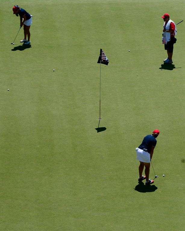 . Brittany Lincicome (left) and Gerina Piller putt during a practice round for the Solheim Cup. The United States has never lost on a home course. (Photo by AAron Ontiveroz/The Denver Post)