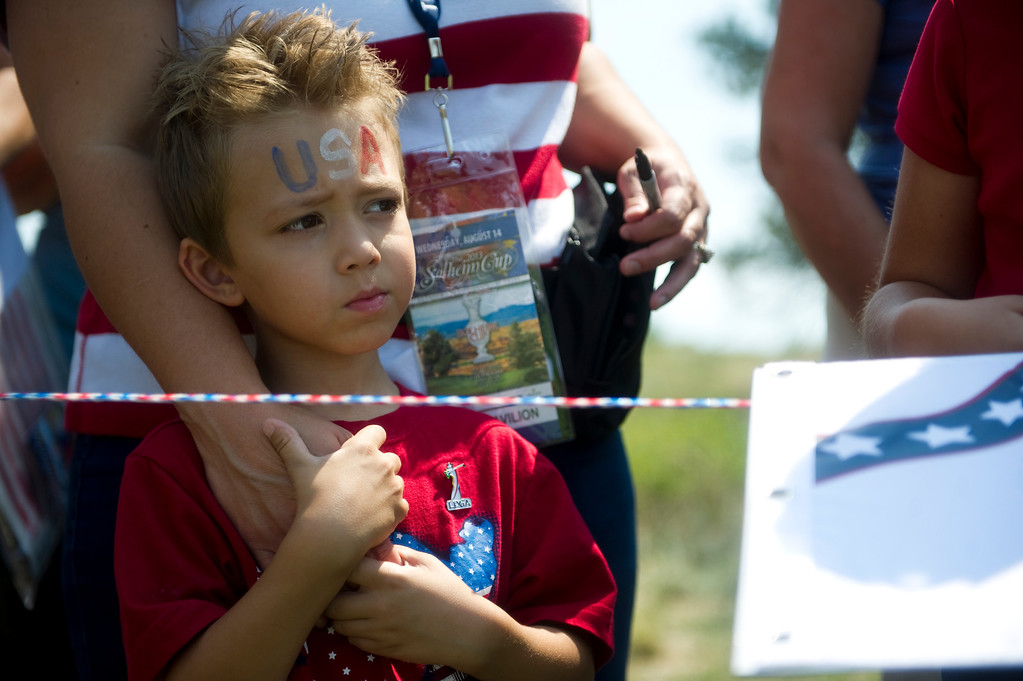 . Mason Royal, 5, from Highlands Ranch, waits for autographs from the American team after they walk off the course from a practice round for the Solheim Cup at Colorado Golf Club on August 14, 2013.  (Photo By Grant Hindsley/The Denver Post)