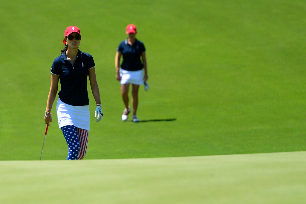 . Michelle Wie (left) and Christie Kerr walk up to the green during a practice round for the Solheim Cup. The United States has never lost on a home course. (Photo by AAron Ontiveroz/The Denver Post)