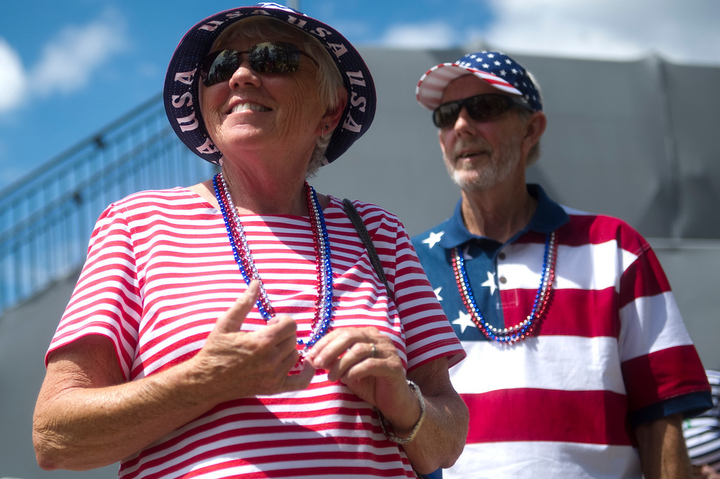 . Gail and Ernest Campbell from Arkansas wait for members of the US Team to walk off the eighteenth hole after a practice round Colorado Golf Club during the Solheim Cup on Tuesday, August 13, 2013. The American and European Teams practiced Tuesday morning. (Photo By Grant Hindsley/The Denver Post)