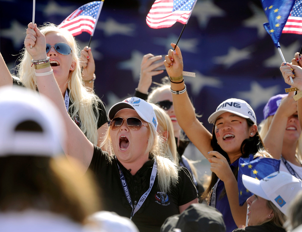 . Golfers who participated in the Junior Solheim Cup showed their emotions Thursday. Following a final practice round at the Colorado Golf Club the United States team and the team from Europe participated in opening ceremonies to being competition for the Solheim Cup Thursday evening, August 15, 2013. Photo By Karl Gehring/The Denver Post