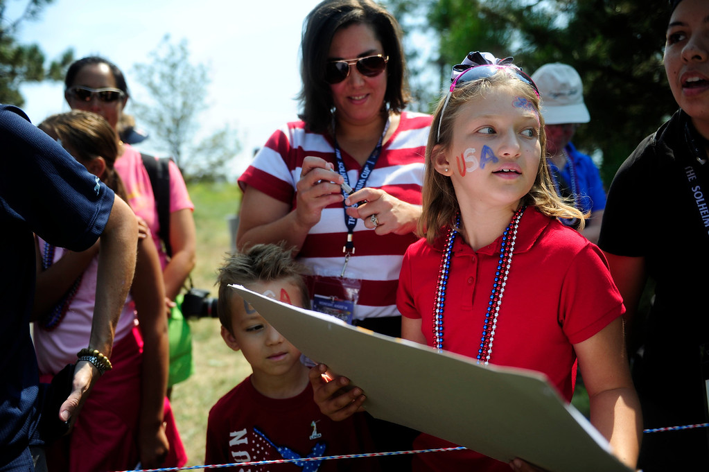 . Meghan Royal, 9, from Highlands Ranch, waits for autographs from the American team after they walk off the course from a practice round for the Solheim Cup at Colorado Golf Club on August 14, 2013.  (Photo By Grant Hindsley/The Denver Post)