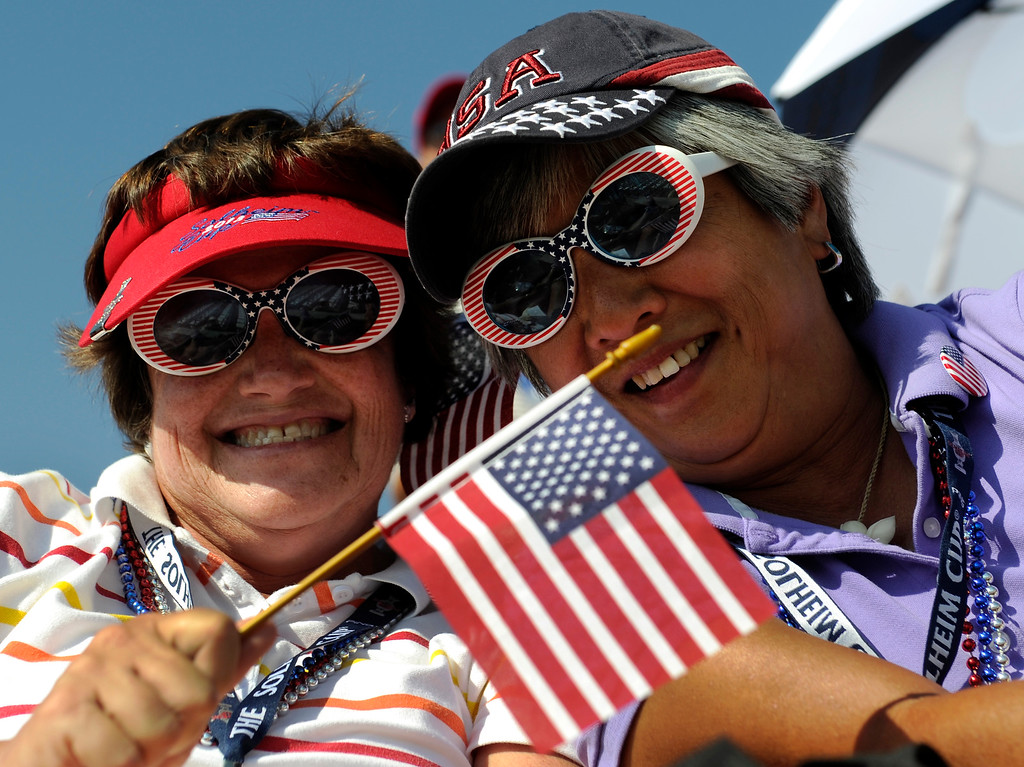 . Jean Anne Depteraolo, left, and Diane Griffith, right, attended opening ceremonies Thursday. Following a final practice round at the Colorado Golf Club the United States team and the team from Europe participated in opening ceremonies to being competition for the Solheim Cup Thursday evening, August 15, 2013. Photo By Karl Gehring/The Denver Post