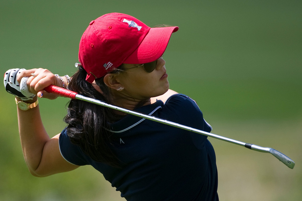 . Michelle Wie watches her fairway shot on hole eighteen during a practice round for the Solheim Cup at the Colorado Golf Club on Tuesday, August 13, 2013. The American and European Teams practiced Tuesday morning. (Photo By Grant Hindsley/The Denver Post)