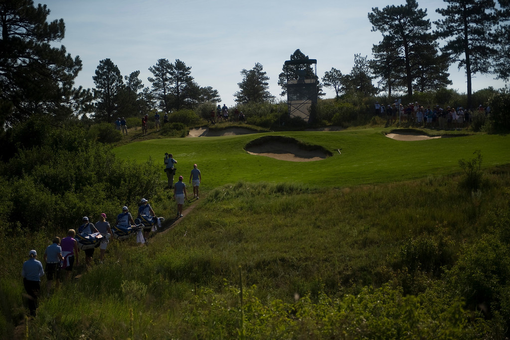 . Members of the European team approach the green on the second hole during a practice round for the Solheim Cup at Colorado Golf Club on August 14, 2013.  (Photo By Grant Hindsley/The Denver Post)