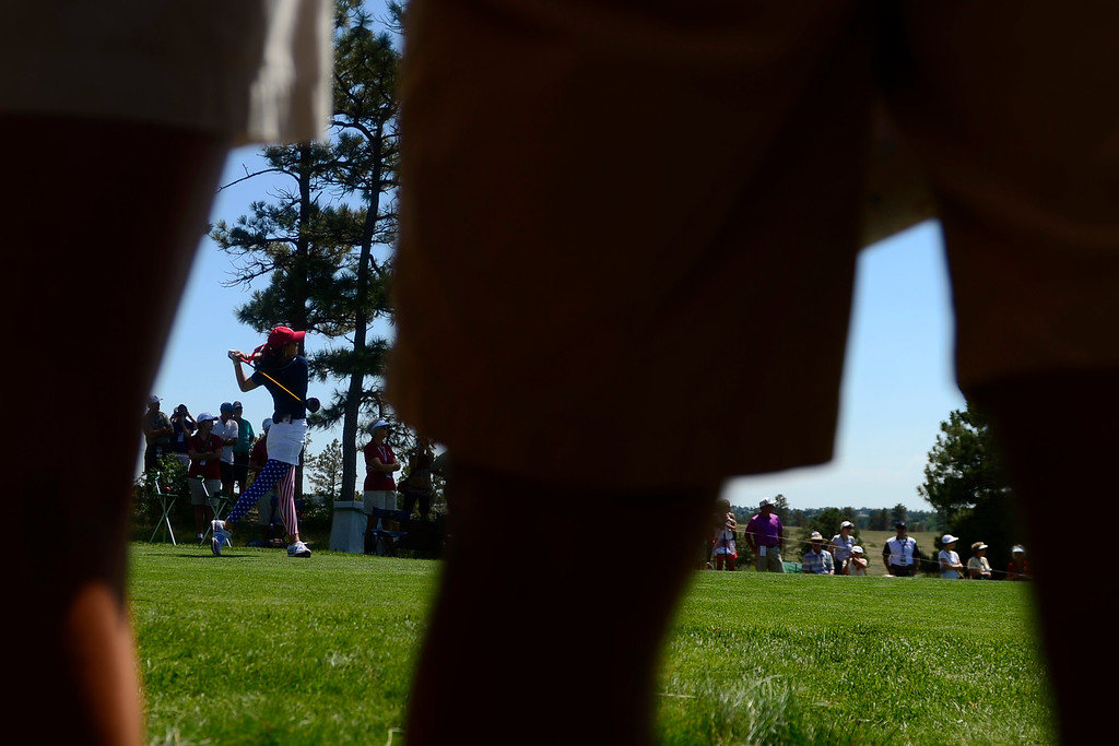 . Michelle Wie tees off during a practice round for the Solheim Cup. The United States has never lost on a home course. (Photo by AAron Ontiveroz/The Denver Post)