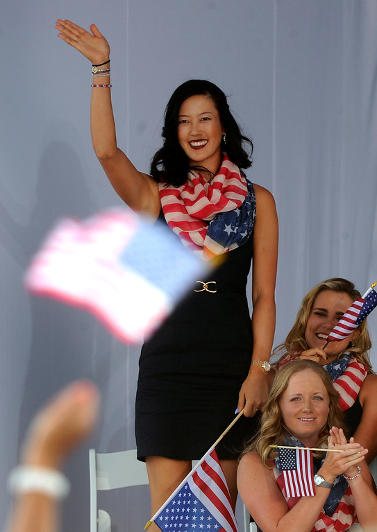 . American golfer Michelle Wie waived to the crowd as she was introduced Thursday. Following a final practice round at the Colorado Golf Club the United States team and the team from Europe participated in opening ceremonies to being competition for the Solheim Cup Thursday evening, August 15, 2013. Photo By Karl Gehring/The Denver Post
