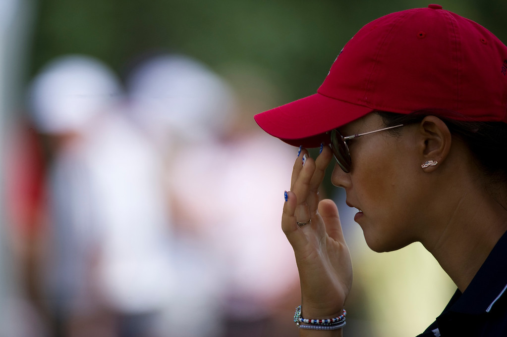 . Michelle Wie of Team USA, pushes on her glasses before teeing off on the sixteenth hole during a practice round for the Solheim Cup Colorado Golf Club on Tuesday, August 13, 2013. The American and European Teams practiced Tuesday morning. (Photo By Grant Hindsley/The Denver Post)
