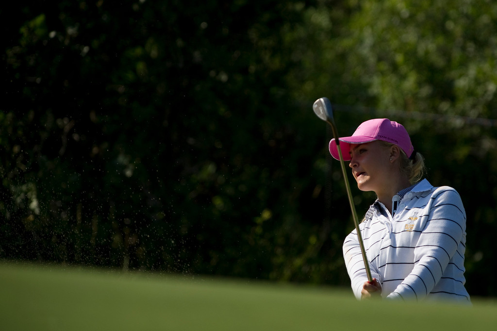 . European Charley Hull watches her bunker shot on hole #2 during a practice round for the Solheim Cup at Colorado Golf Club on August 14, 2013.  (Photo By Grant Hindsley/The Denver Post)