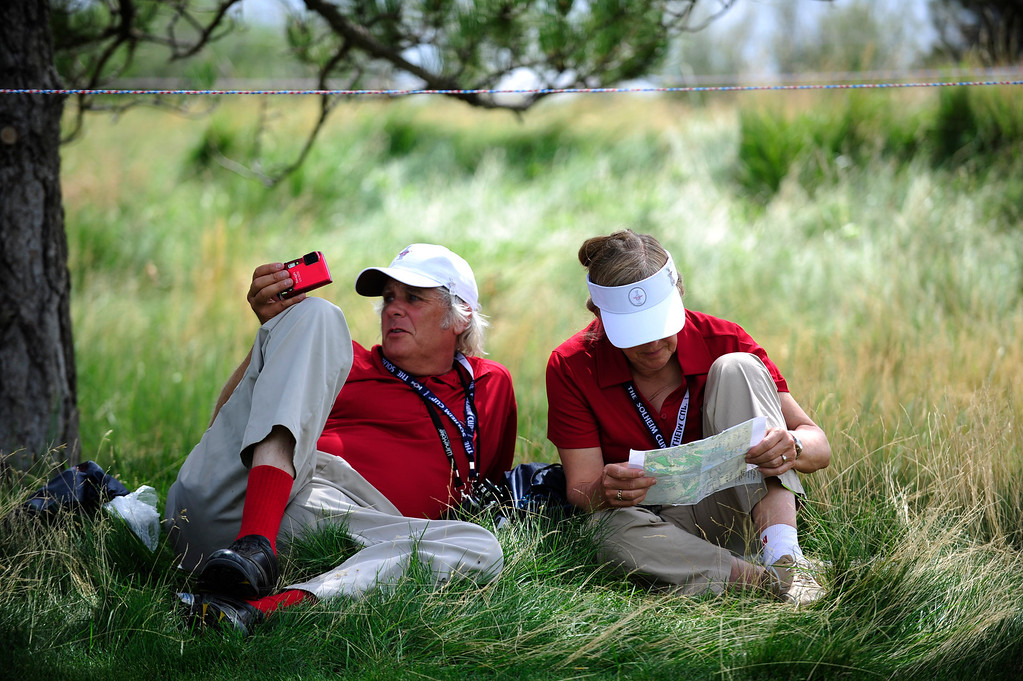 . Solheim Cup Volunteers Warren and Carla Montgomery from Illinois rest in the shade near the sixteenth green at the Colorado Golf Club on Tuesday, August 13, 2013. The American and European Teams practiced Tuesday morning. (Photo By Grant Hindsley/The Denver Post)