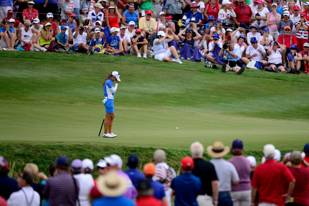 . Europe\'s Azahara Munoz reacts to missing a putt while playing the 16th against Brittany Lang during the final round of the Solheim Cup. A win marks the first time the Europeans have won the competition in the United States. (Photo by AAron Ontiveroz/The Denver Post)