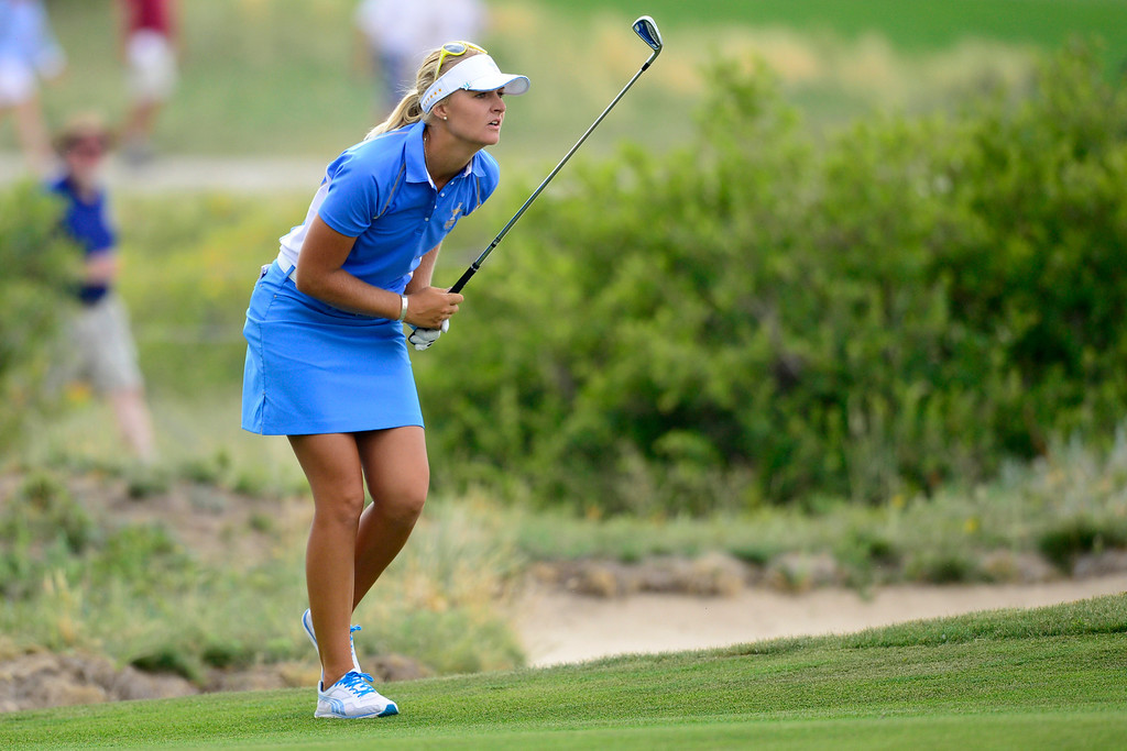 . Europe\'s Anna Nordqvist watches her approach shot before going all even with Stacy Lewis on the 17th during the final round of the Solheim Cup. A win marks the first time the Europeans have won the competition in the United States. (Photo by AAron Ontiveroz/The Denver Post)