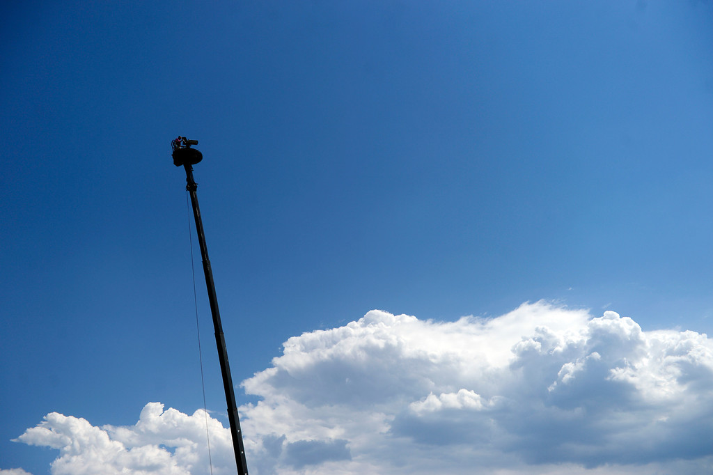 . A camera man works high in the sky during the final round of the Solheim Cup. A win marks the first time the Europeans have won the competition in the United States. (Photo by AAron Ontiveroz/The Denver Post)