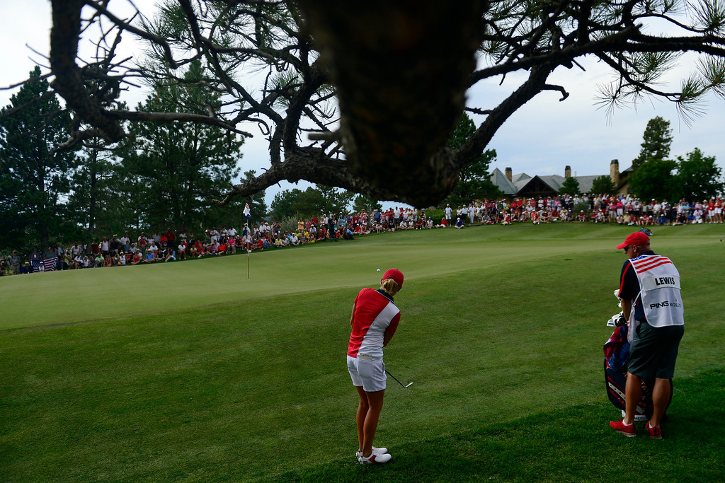 . Stacy Lewis hits a chip shot on the 18th during the final round for the Solheim Cup. A win marks the first time the Europeans have won the competition in the United States. (Photo by AAron Ontiveroz/The Denver Post)