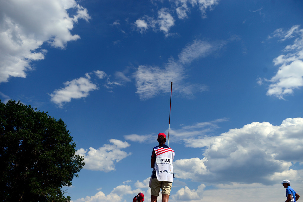 . Gerina Piller\'s caddy watches the action during the final round for the Solheim Cup. A win marks the first time the Europeans have won the competition in the United States. (Photo by AAron Ontiveroz/The Denver Post)