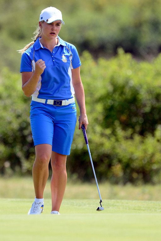 . Charley Hull pumps her fist after making a putt on the sixth during the final round of the Solheim Cup. A win marks the first time the Europeans have won the competition in the United States. (Photo by AAron Ontiveroz/The Denver Post)