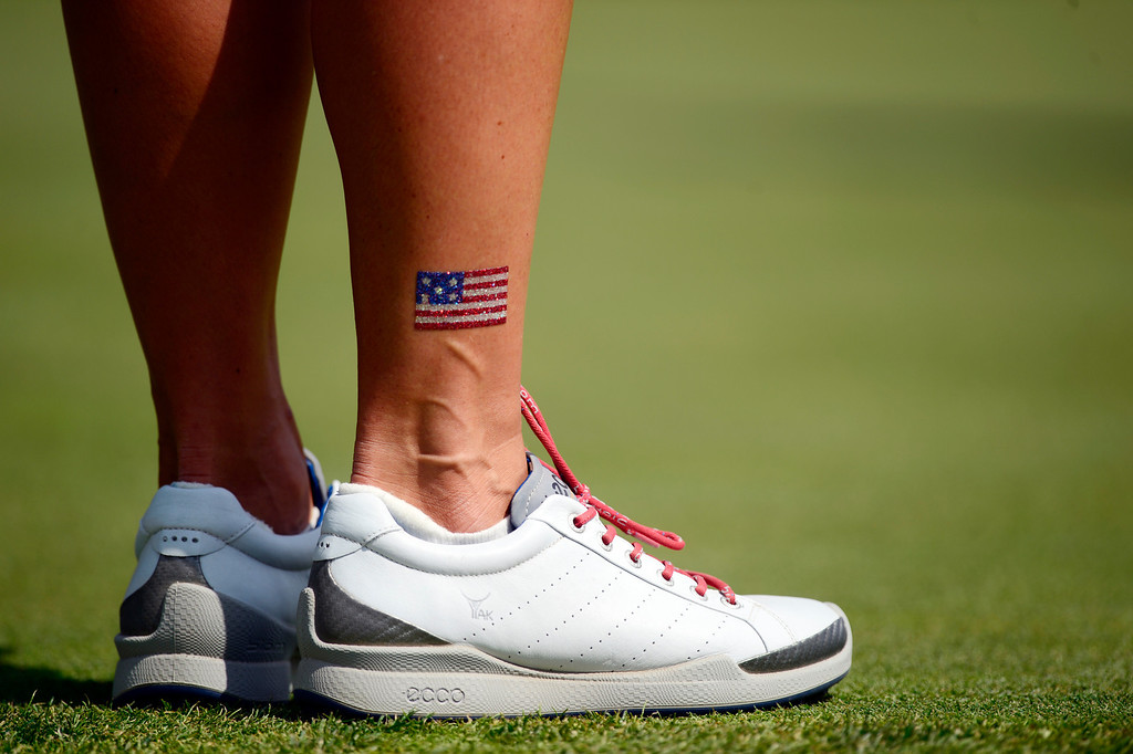 . Gerina Piller wears American flag art while playing against Catriona Matthew during the final round of the Solheim Cup. A win marks the first time the Europeans have won the competition in the United States. (Photo by AAron Ontiveroz/The Denver Post)