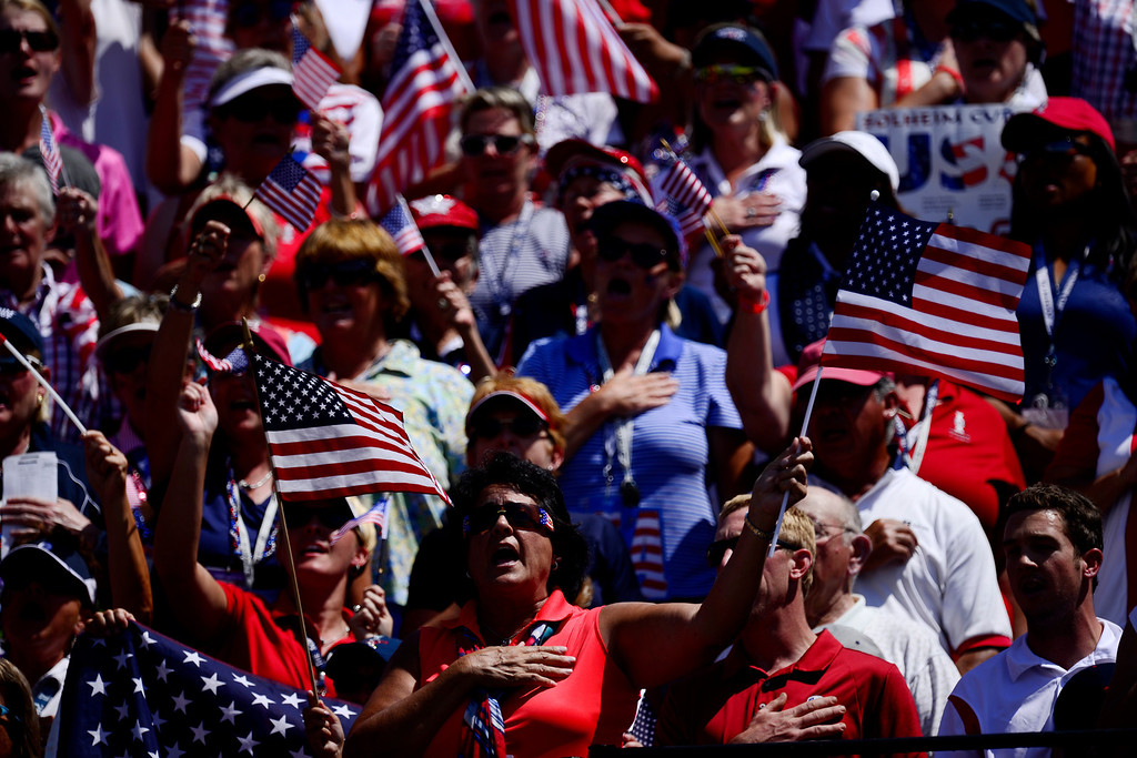 . American fans cheer on Stacy Lewis before teeing off first during the final round of the Solheim Cup. A win marks the first time the Europeans have won the competition in the United States. (Photo by AAron Ontiveroz/The Denver Post)