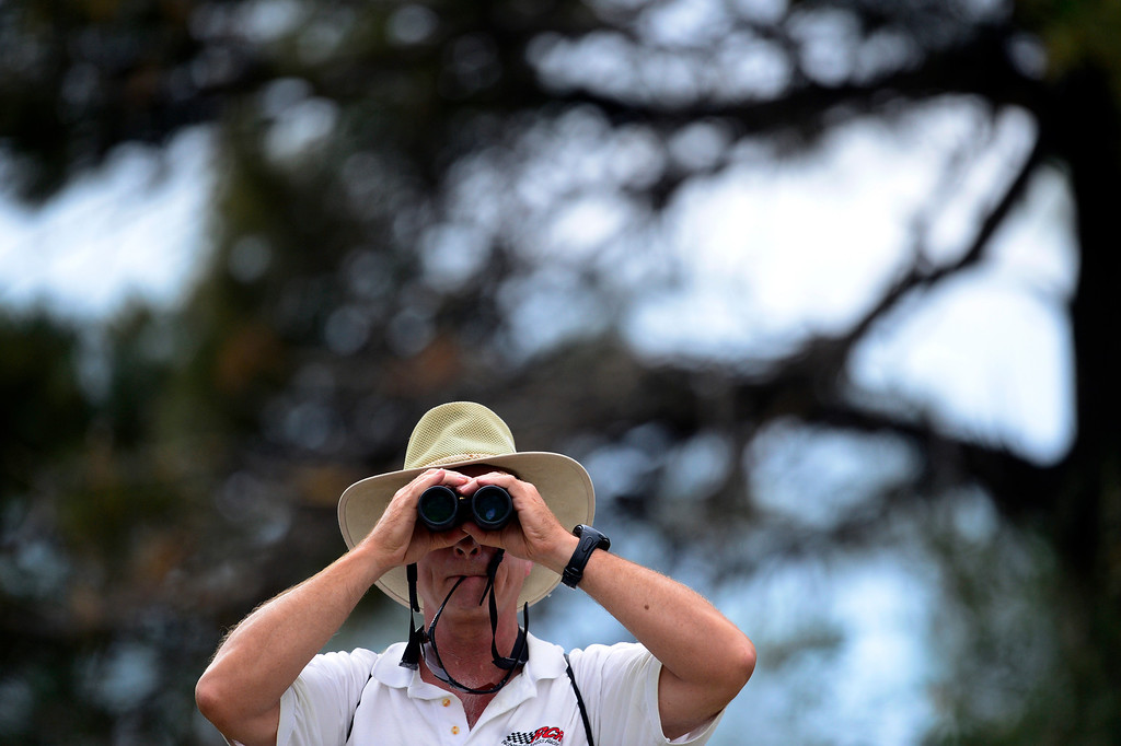 . A spectator watches the action on the 16th during the final round of the Solheim Cup. A win marks the first time the Europeans have won the competition in the United States. (Photo by AAron Ontiveroz/The Denver Post)