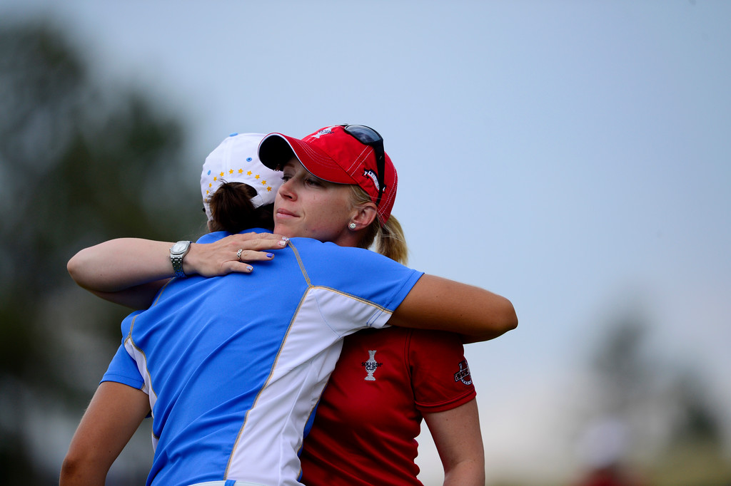 . Morgan Pressel hugs Carlota Ciganda after losing to her during the final round of the Solheim Cup. A win marks the first time the Europeans have won the competition in the United States. (Photo by AAron Ontiveroz/The Denver Post)