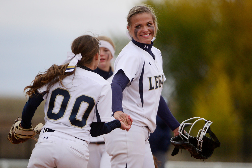 . Legacy\'s Taylor Brothers (00) high fives pitcher Haley Smith (99) during the Lightning\'s 6-4 state title win at the Aurora Sports Park on Sunday, October 20, 2013. The win was Legacy\'s sixth title in seven years. (Photo by AAron Ontiveroz/The Denver Post)