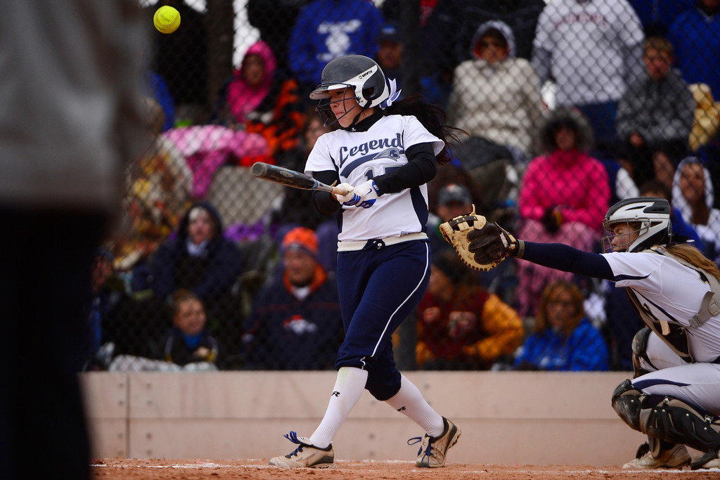 . Legend\'s Kaley Garcia rips a foul ball against Legacy during the Lightning\'s 6-4 state title win at the Aurora Sports Park on Sunday, October 20, 2013. The win was Legacy\'s sixth title in seven years. (Photo by AAron Ontiveroz/The Denver Post)