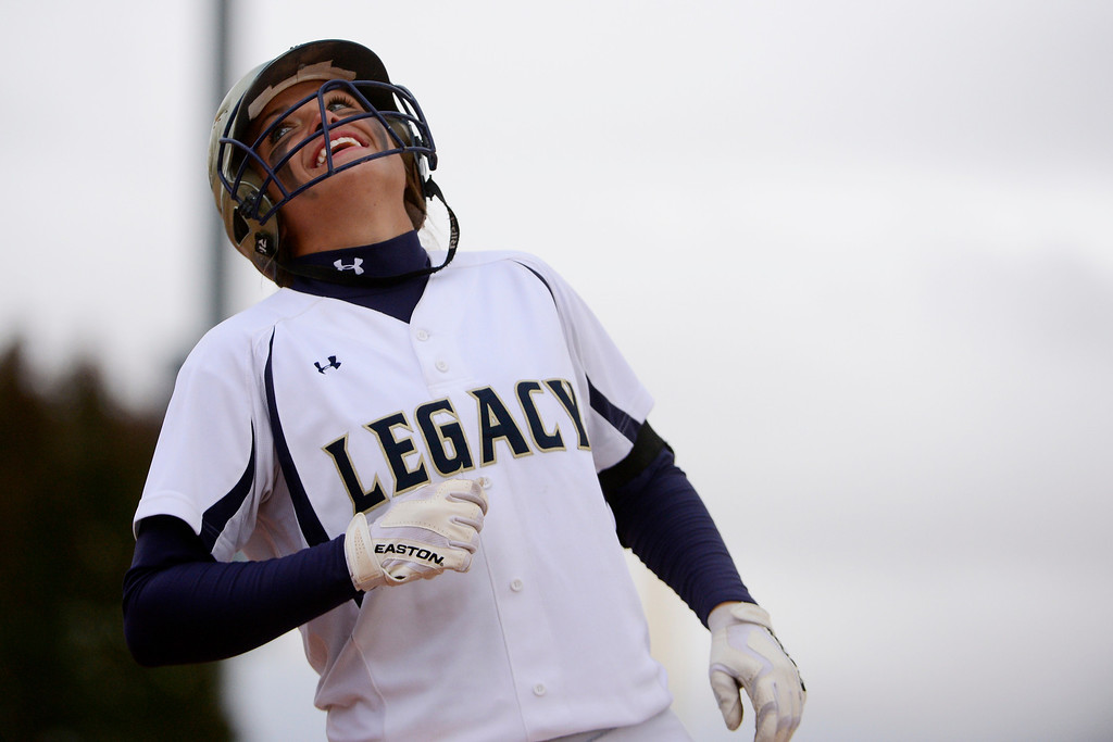 . Legacy\'s Haley Smith reacts to grounding out against Legend during the Lightning\'s 6-4 state title win at the Aurora Sports Park on Sunday, October 20, 2013. The win was Legacy\'s sixth title in seven years. (Photo by AAron Ontiveroz/The Denver Post)