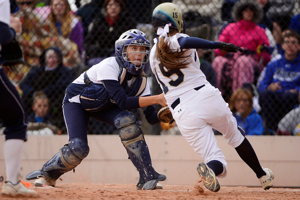 . Legend catcher Robyn Leighton prepares to tag Legacy\'s Shania Leon during Legacy\'s 6-4 state title win at the Aurora Sports Park on Sunday, October 20, 2013. The win was Legacy\'s sixth title in seven years. (Photo by AAron Ontiveroz/The Denver Post)