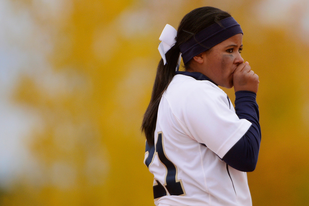 . Legacy second baseman Celyn Whitt blows into her hand while playing Legend during the Lightning\'s 6-4 state title win at the Aurora Sports Park on Sunday, October 20, 2013. The win was Legacy\'s sixth title in seven years. (Photo by AAron Ontiveroz/The Denver Post)