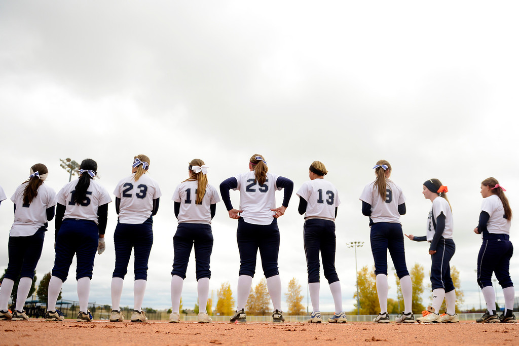 . Legend players stand for the introductions before the start of their 6-4 state title loss to Legacy at the Aurora Sports Park on Sunday, October 20, 2013. The win was Legacy\'s sixth title in seven years. (Photo by AAron Ontiveroz/The Denver Post)