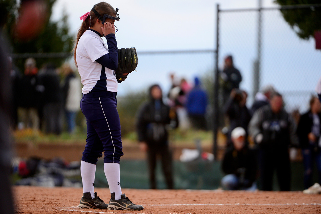 . Legend pitcher Janelle Gardner reacts to giving up a run to Legacy during Legacy\'s 6-4 state title win at the Aurora Sports Park on Sunday, October 20, 2013. The win was Legacy\'s sixth title in seven years. (Photo by AAron Ontiveroz/The Denver Post)