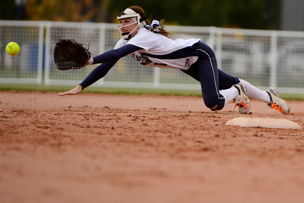 . Legend\'s Brooke Doumer cannot wrangle a shot up the middle during Legacy\'s 6-4 state title win at the Aurora Sports Park on Sunday, October 20, 2013. The win was Legacy\'s sixth title in seven years. (Photo by AAron Ontiveroz/The Denver Post)