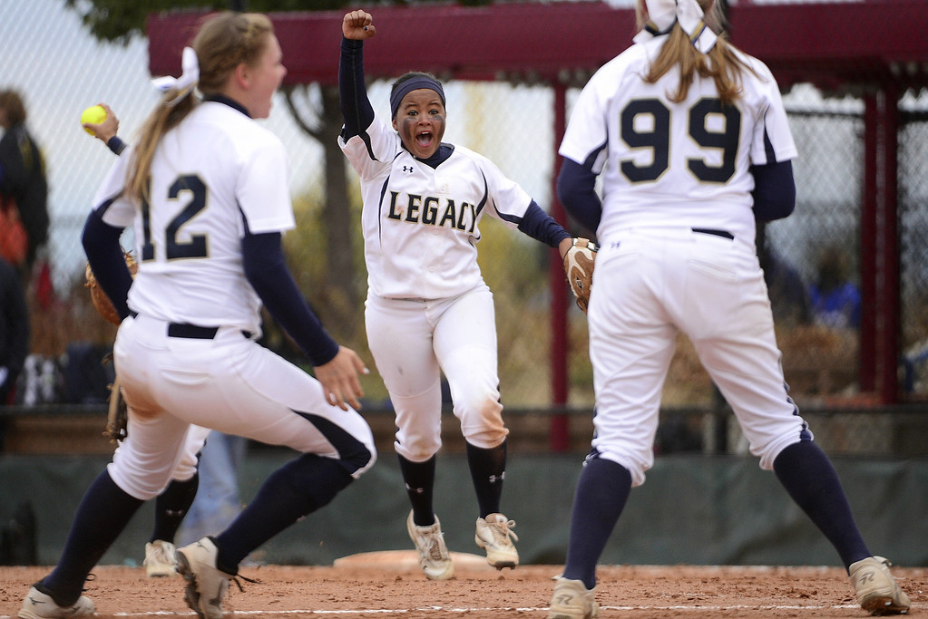 . Legacy second baseman Celyn Whitt (21) celebrates after fielding the final out of the game -- a grounder to second hit by Legend\'s Steph Cardona (3) to cap the Lightning\'s 6-4 CHSAA state title win at the Aurora Sports Park on Sunday, October 20, 2013. The championship is the sixth in seven years for Legacy. (Photo by AAron Ontiveroz/The Denver Post