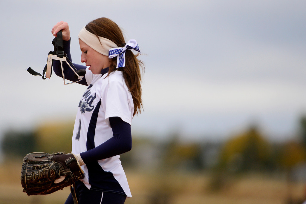 . Legend\'s Brooke Doumer adjusts her face mask while playing Legacy during the Lightning\'s 6-4 state title win at the Aurora Sports Park on Sunday, October 20, 2013. The win was Legacy\'s sixth title in seven years. (Photo by AAron Ontiveroz/The Denver Post)