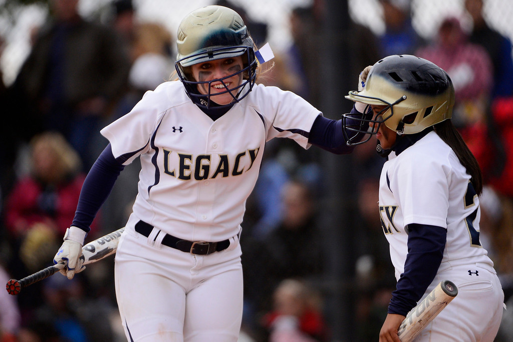 . Legacy\'s Maddie Ertle (left) celebrates her run with teammate Celyn Whitt during the Lightning\'s 6-4 state title win at the Aurora Sports Park on Sunday, October 20, 2013. The win was Legacy\'s sixth title in seven years. (Photo by AAron Ontiveroz/The Denver Post)