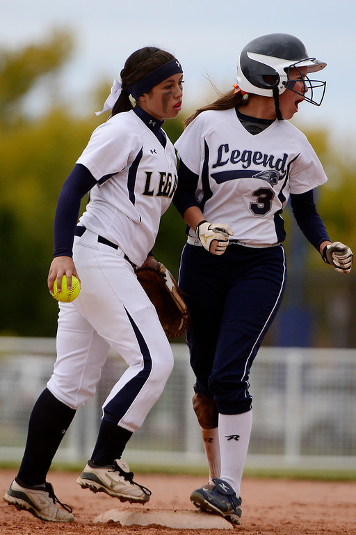 . Legend\'s Steph Cardona celebrates as Legacy shortstop Aspen Eubanks reacts during the Lightning\'s 6-4 state title win at the Aurora Sports Park on Sunday, October 20, 2013. The win was Legacy\'s sixth title in seven years. (Photo by AAron Ontiveroz/The Denver Post)