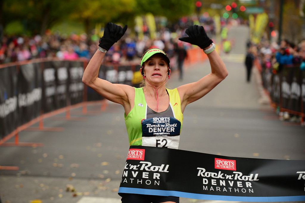 . Nicole Sher wins the women\'s marathon in the 4th annual Rock \'N\' Roll Marathon and 1/2 Marathon sponsored by Sports Authority in Denver, Co on October 20, 2013.  More than 15,000 participants and thousands of spectators, family and friends took part in the festivities that started and ended in Civic Center park. (Photo By Helen H. Richardson/ The Denver Post)